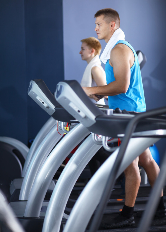 Group of people at the gym exercising on cross trainers