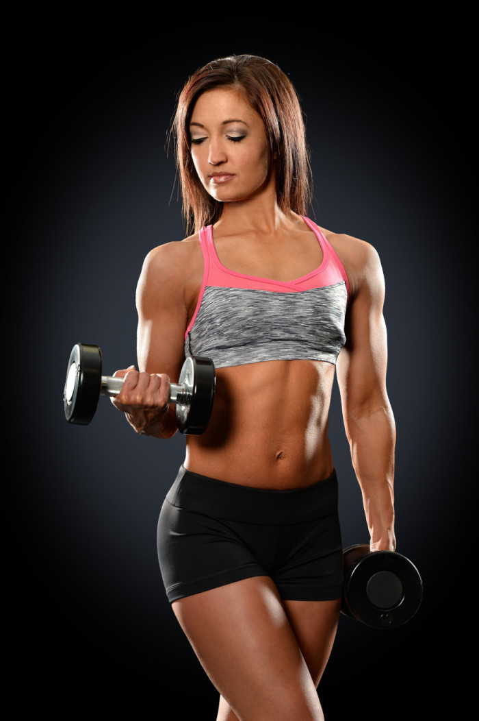 Young Woman Curling Dumbbells